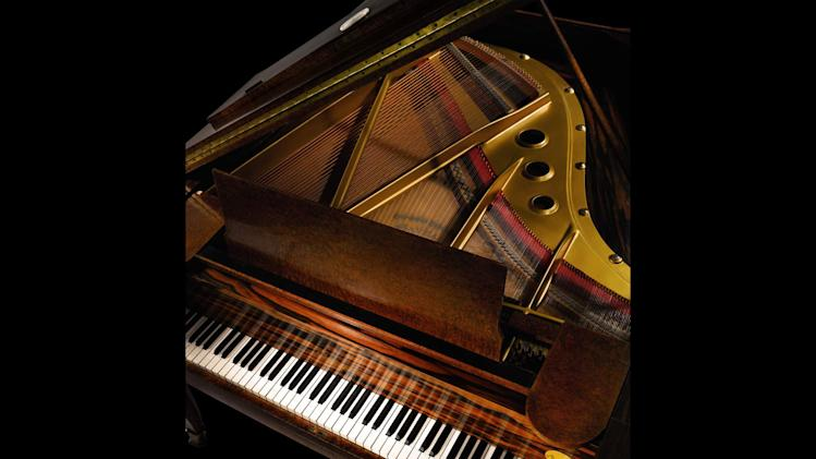 This undated image provided by Sotheby's auction house shows a Emile-Jacques Ruhlmann art deco grand piano that will be up for auction in March. The piano sailed aboard the French ocean liner Normandie in the 1930s and was purchased by the Butler family of Buffalo in the early 1940s. (AP Photo/Sotheby's)