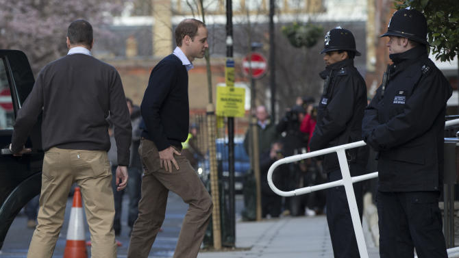 Britain's Prince William arrives at the King Edward VII hospital to visit his wife the Duchess of Cambridge in central London, Wednesday, Dec. 5, 2012.  Prince William and his wife Kate are expecting their first child, and the Duchess of Cambridge has been admitted to hospital suffering from a severe form of morning sickness in the early stages of her pregnancy. (AP Photo/Alastair Grant)
