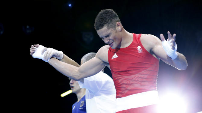 Britain's Anthony Ogogo reacts as he is declared the winner over Germany's Stefan Hartel after their quarterfinal Men's Middle (75kg) boxing match at the London Olympic Games