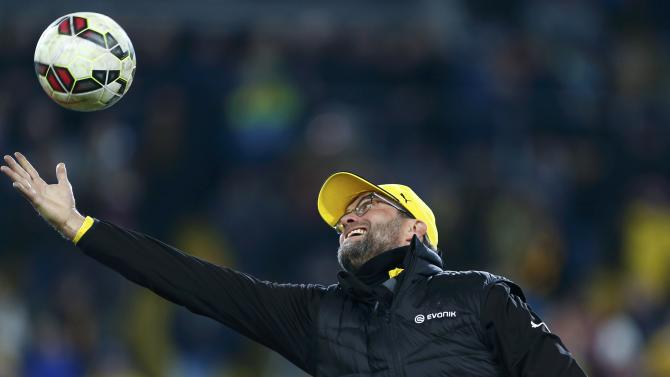 Dortmund's coach Klopp catches a ball as his team's warm up before their DFB Pokal soccer match against Dresden in Dresden