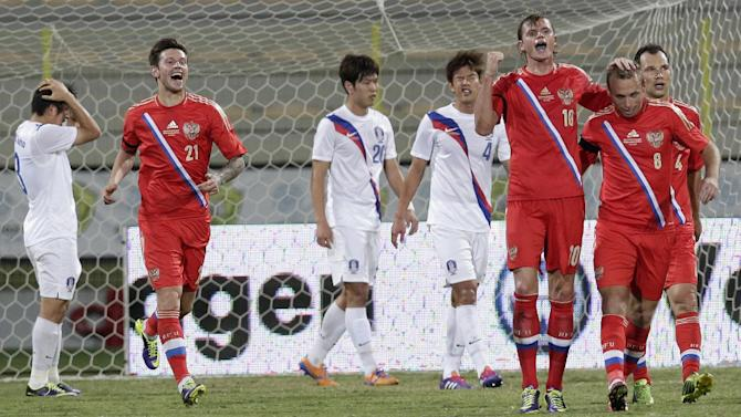 Russia's midfielder Dmitry Tarasov, third right, celebrates with his teammates scoring a goal against South Korea during the international friendly soccer match between Russia and South Korea, in Dubai, United Arab Emirates, Tuesday, Nov. 19, 2013