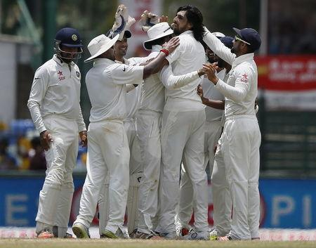 India's Sharma celebrates with his teammates after taking the wicket of Sri Lanka's Thirimanne during the third day of their third and final test cricket match in Colombo