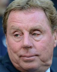 Tottenham Hotspur Manager Harry Redknapp looks on ahead of the the FA Cup semi-final football match between Tottenham Hotspur and Chelsea at Wembley Stadium in London. Redknapp called for the swift introduction of goal-line technology after a key decision went against Spurs in their 5-1 FA Cup semi-final thrashing by Chelsea