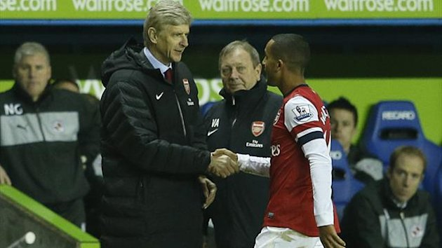 Arsenal's Theo Walcott (R) is thanked by manager Arsene Wenger after being substituted during their English Premier League match against Reading at the Madejski stadium (Reuters)