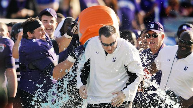 Northwestern coach Pat Fitzgerald is doused in the closing minute of the Wildcats 34-20 victory over Mississippi State in the Gator Bowl NCAA college football game, Tuesday, Jan. 1, 2013, in Jacksonville, Fla.   (AP Photo/The Florida Times-Union, Bob Self)