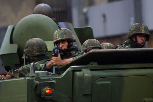 Brazilian marines' APCs leave the Caju shantytown in Rio de Janeiro, Brazil, on March 3, 2013