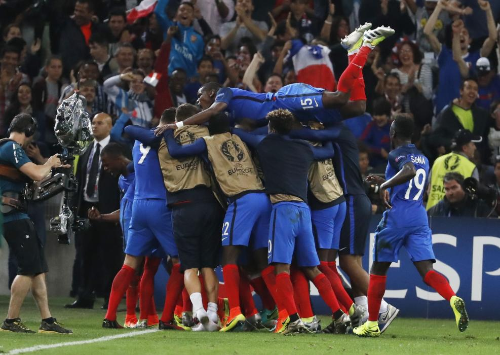 France's Antoine Griezmann celebrates after scoring their first goal with team mates