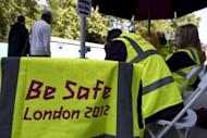 """A volunteer's vest inscribed with the message """"Be Safe"""" hangs on a chair as London 2012 Olympic Games volunteers wait to guide people at an Olympic transport hub in London on July 22. Britain's biggest peacetime security operation geared up Monday for the start of the London 2012 Games just four days away, with soldiers in camouflage manning the airport-style gates at Olympic Park"""