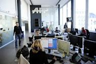 "Journalists of Agence France-Presse work at headquarters in Paris. Agence France-Presse launched ""the e-diplomacy hub"" on Thursday, an Internet-based application that measures and visualises the presence and influence of diplomatic actors on Twitter"
