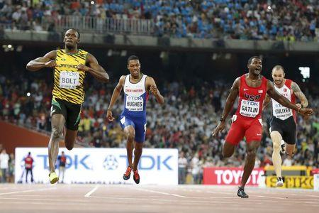 Usain Bolt of Jamaica crosses the finish line ahead of Justin Gatlin from the U.S. in the men's 200m final during the 15th IAAF World Championships at the National Stadium in Beijing