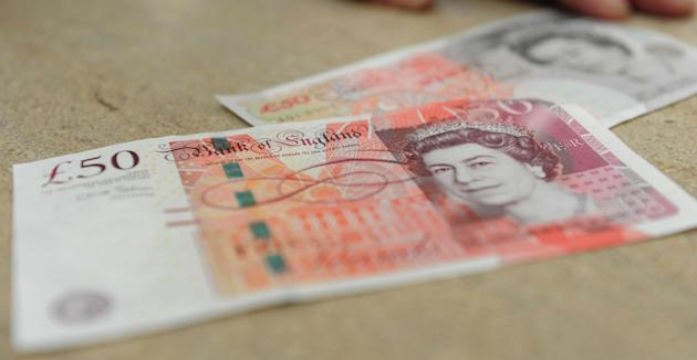 The new £50 note (left) replaces the old £50 note (right). Picture by: Georgie Gillard/Press Association Images