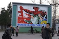 North Koreans stand in front of a political mural in Pyongyang in April 2012. Following Kim Jong-Il's death last December, the country revised the charter to consecrate achievements of the late leader, who was succeeded by his son Kim Jong-Un