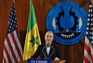 US Secretary of State Hillary Clinton speaks during a press conference at Dakar University on August 1. Clinton arrived in the Ugandan capital Kampala, which has been hit by an Ebola outbreak and where she will spend one night before heading to South Sudan