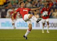 Former England striker Michael Owen, seen here in 2011, thinks he could still feature for Premier League title-chasers Manchester United before the end of the season, despite being sidelined by a string of injuries