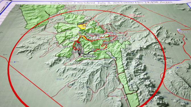 This Monday, July 8, 2013 photo shows a map of the Carpenter 1 fire TFR, or temporary flight restriction zone, at Centennial High School, the Carpenter 1 fire command center, in Las Vegas. The wildfire, which encompasses thousands of acres, began last Monday. (AP Photo/Las Vegas Review-Journal, Jessica Ebelhar)