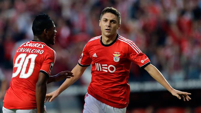 Benfica's Siqueira, from Brazil, celebrates scoring with teammate Ivan Cavaleiro, left, during their Portuguese league soccer match against Nacional, Sunday Oct. 27, 2013, at Benfica's Luz stadium in Lisbon