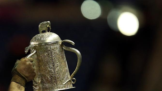 England's captain Chris Robshaw holds up the The Calcutta Cup after defeating Scotland in their Six Nations rugby union international match at Murrayfield, Edinburgh, Scotland, Saturday Feb. 8, 2014. (AP Photo/Scott Heppell)