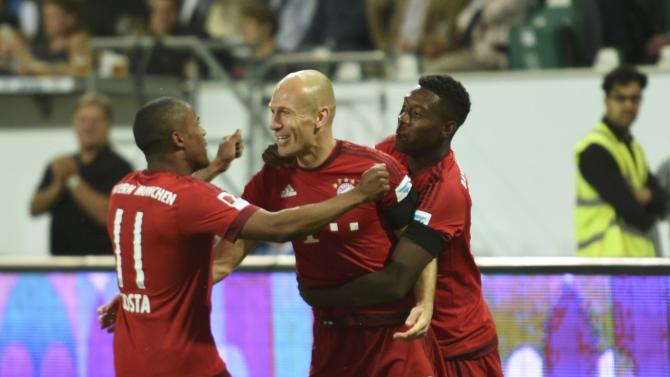 Bayern Munich's Arjen Robben celebrates with his team mates Costa and Alaba after scoring goal against VfL Wolfsburg during German Supercup soccer match in Wolfsburg
