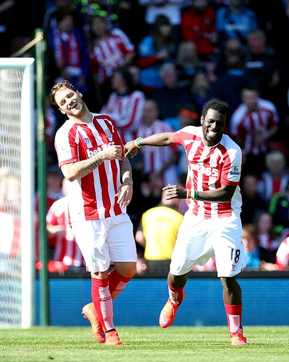 Stoke City's Mame Diouf, right, celebrates scoring his side's first goal of the game against Southampton with teammate Marko Arnautovic during their English Premier League soccer match at the