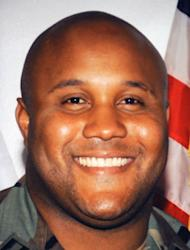 Fired Los Angeles Police Department (LAPD) officer Christopher Dorner seen in an undated photo wearing a military uniform on display at a press conference regarding the manhunt for Dorner, at LADP headquarters in Los Angeles February 7, 2013