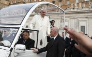 Pope Francis looks on as he arrives to lead the general audience in Saint Peter's Square at the Vatican February 12, 2014. REUTERS/Tony Gentile (VATICAN - Tags: RELIGION)