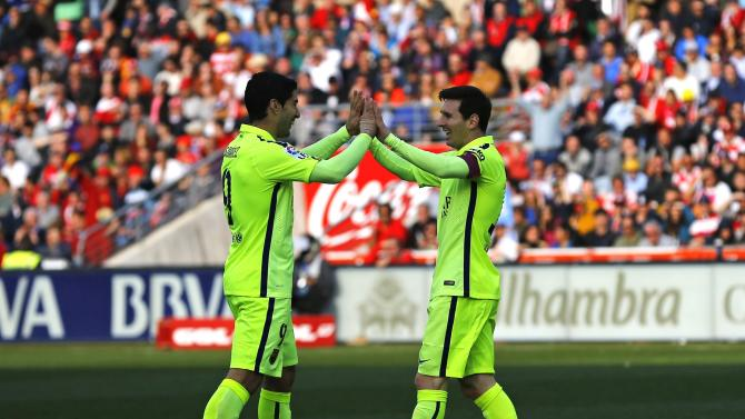 Barcelona's Messi is congratulated by teammate Suarez after scoring a goal against Granada during their Spanish first division soccer match in Granada