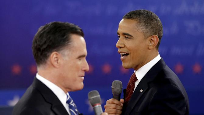 FILE - In this Oct. 16, 2012 file photo, President Barack Obama, right, and Republican presidential candidate, former Massachusetts Gov. Mitt Romney exchange views during the second presidential debate at Hofstra University in Hempstead, N.Y. Obama and Romney, bitter campaign foes just weeks ago, are to share a lunch on Thursday, Nov. 29, 2012, at the White House with an eye on overlapping interests rather than the sharp differences that defined their presidential contest. (AP Photo/David Goldman, File)