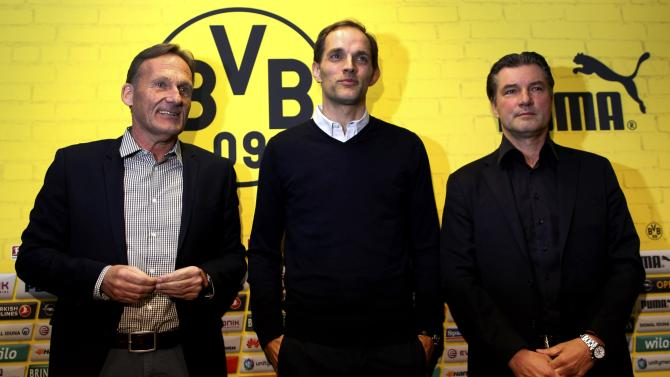 Borussia Dortmund's CEO Watzke, new coach Tuchel and sport director Zorc pose after a news conference in Dortmund