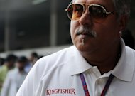 Chairman and CEO of India's Kingfisher Airlines Vijay Mallya is pictured in New Delhi on October 27, 2012. The boss of India's troubled Kingfisher airline has sought to allay fears about jobs in a rare communication to staff, which outlines plans to restart limited operations and win a foreign investment deal