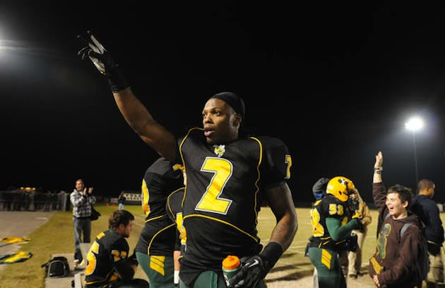 Derrick Henry acknowledges the crowd after setting the national career high school rushing record — Associated Press