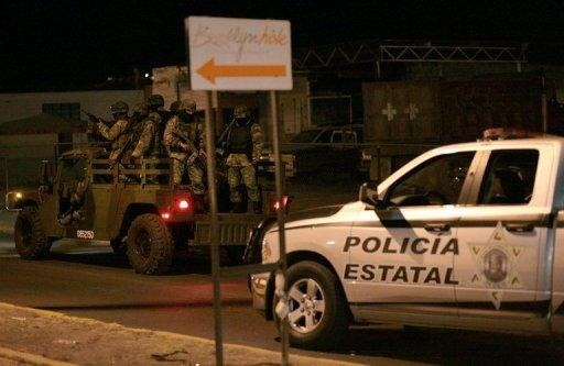 Mexican troops in combat gear and police patrol the streets in the Guadalupe municipality, Zacatecas state, on February 1, 2011. Mexican soldiers killed at least 12 suspected criminals in a running gun battle across the central state of Zacatecas on Wednesday.