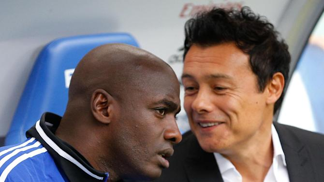 Hamburg's interim head coaches Otto Addo and Rodolfo Cardoso , right,  talk to each other prior to the German Bundesliga soccer match between Hamburger SV and SV Werder Bremen  in Hamburg, Germany,  Saturday Sept. 21, 2013