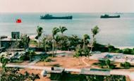 This photo released by the Military Information Agency (MIA) in Taiwan shows two Taiwanese warships docking near the shore of Taiping Island in 1995. Taiwan's navy has taken a group of academics to contested islands in the South China Sea, the second such trip in five weeks, the defence ministry said Wednesday amid mounting tensions in the area