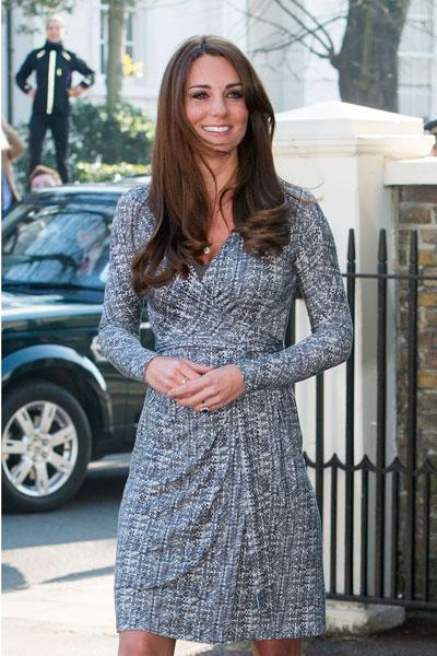 Kate, who is due with her and William's first child in July, rocked a print Max Mara wrap dress for the appearance. She was seen resting her hands on her growing bump and looking happy and healthy. (Photo by Neil Mockford/FilmMagic)