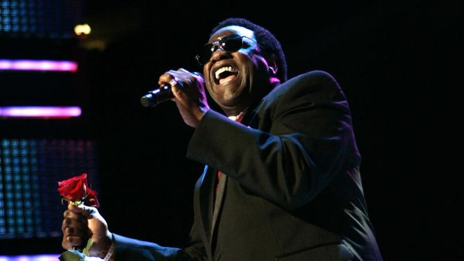 """FILE - This July 5, 2009 file photo shows Al Green performing during the Essence Music Festival in New Orleans. Jennifer Hudson sang Green's classic """"Let's Stay Together,"""" at an inaugural ball Monday, Jan. 21, 2013, leaving many to wonder why the soul legend wasn't singing his own hit for President Barack Obama and first lady Michelle Obama. In a statement to The Associated Press, his representative said Green had been asked to sing, but scheduling conflicts prevented him from attending Monday's festivities. Green said he'd be honored to sing for the president in the future. (AP Photo/Patrick Semansky, file)"""
