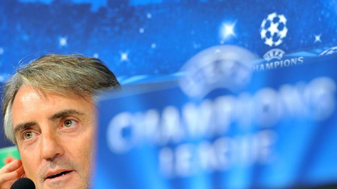 Galatasaray coach Roberto Mancini answers questions during a press conference ahead of Wednesday's Champions League, group B soccer match between Juventus and Galatasaray, at the Juventus stadium, in Turin, Italy, Tuesday, Oct. 1, 2013. Galatasaray's new coach Roberto Mancini knows that facing Juventus in the Champions League just two days after taking charge of the Turkish team is going to be tough, but hopes his Italian background will be an advantage. Mancini, who was confirmed as Fatih Terim's replacement on Monday, spent almost his entire managerial career in Italy, with Fiorentina, Lazio and Inter Milan, before joining Manchester City in 2009