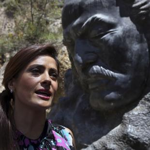 "Mexican and American actress Salma Hayek sits in front of the statue of Lebanese-American poet Khalil Gibran during her visit to his museum in the northeast mountain town of Bcharre, Lebanon, Sunday, April 26, 2015. Hayek visited her ancestral homeland Lebanon to launch her latest film ""The Prophet,"" a screen adaptation of the book by the same name written nearly a century ago by the famed Lebanese-American poet and philosopher Gibran. (AP Photo/Bilal Hussein)"
