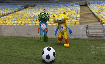 The unnamed mascots of the Rio 2016 Olympic and Paralympic Games are pictured during a visit at the Maracana Stadium in Rio de Janeiro