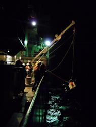 Researchers aboard the ship Revelle retrieve an instrument sent down into the Tonga Trench, the second deepest trench in the ocean, during an expedition in the summer of 2012.