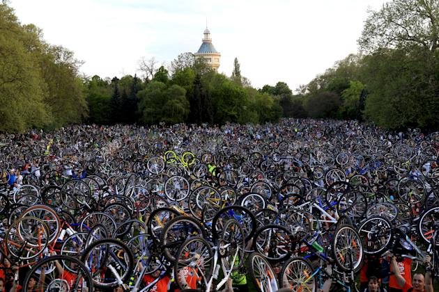 Thousands of cyclists hold up their bicycles after riding around the Hungarian capital Budapest