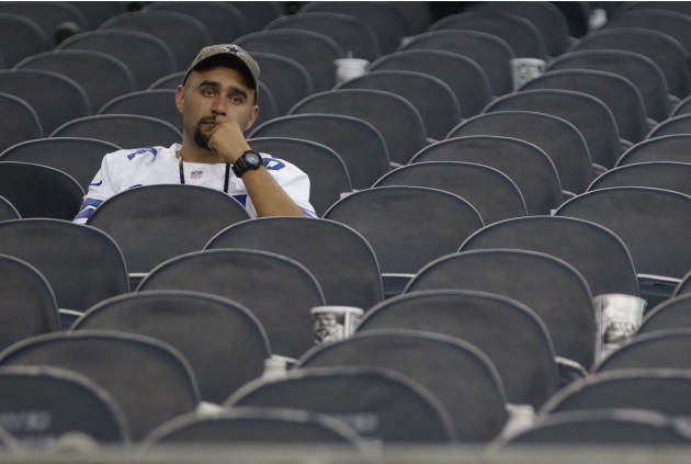 A Dallas Cowboys fan sits in the stands afar the NFL football game against San Francisco 49ers Sunday, Sept. 7, 2014, in Arlington, Texas. (AP Photo/LM Otero)