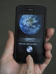 "The ""Siri"" digital personal assistant is displayed on an Apple iPhone 4S in Washington, DC on March 13, 2012. Apple's Siri, which made its debut with the release of the iPhone 4S in 2011, was first developed in 2007."