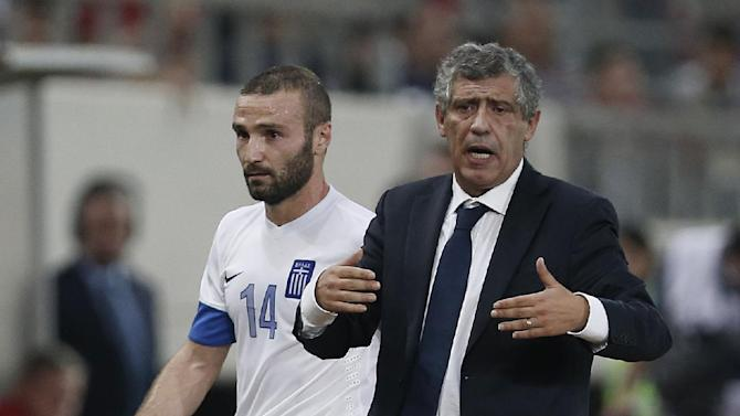 Greece's coach Fernando Santos from Portugal, right, gives directions to his players as Dimitris Salpigidis leaves the pitch during a World Cup Group G qualifying soccer match against Slovakia at the Karaiskaki stadium in the port of Piraeus, near Athens, Friday, Oct. 11, 2013. Greece won 1-0