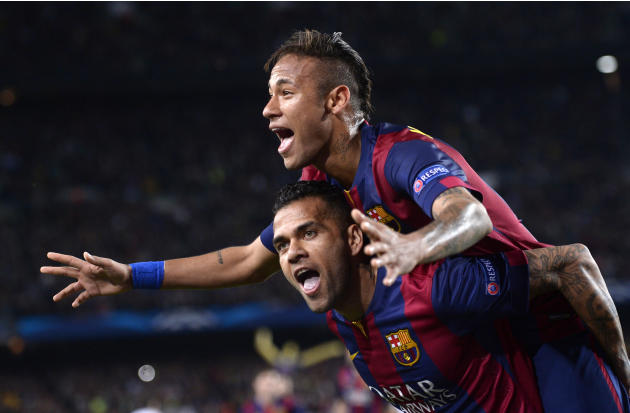 FILE - In this Tuesday, April 21, 2015 file photo Barcelona's Neymar celebrates on the shoulders of teammate Dani Alves, after scoring his second goal during the Champions League quarterfinal seco