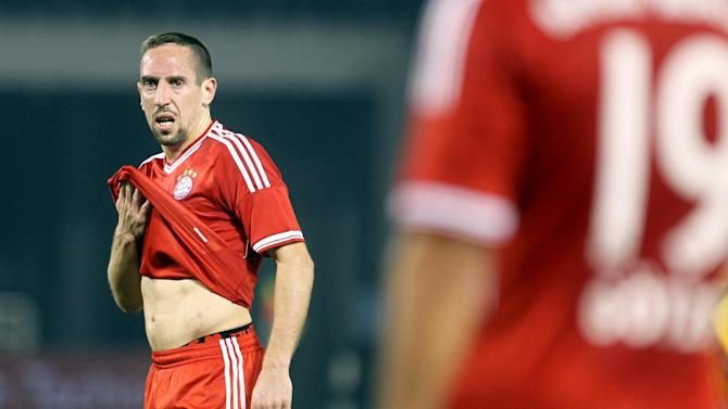 Bayern Munich's Franck Ribery reacts  during their friendly soccer match against Al-Merreikh SC , at Al-Saad stadium in Doha Thursday, Jan. 9, 2014
