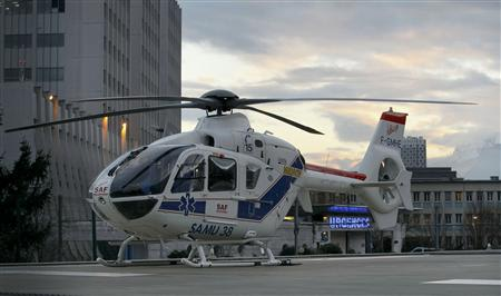 An helicopter stands outside the CHU Nord hospital in Grenoble, French Alps, where retired seven-times Formula One world champion Michael Schumacher is reported to be hospitalized after a ski accident, December 29, 2013. REUTERS/Robert Pratta