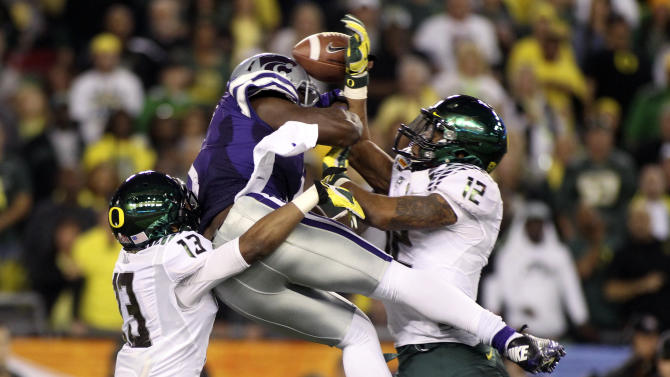 Kansas State Wildcats Chris Harper has his touchdown pass broken up by Oregon Ducks Brian Jackson and Troy Hill during the Fiesta Bowl football game in Glendale
