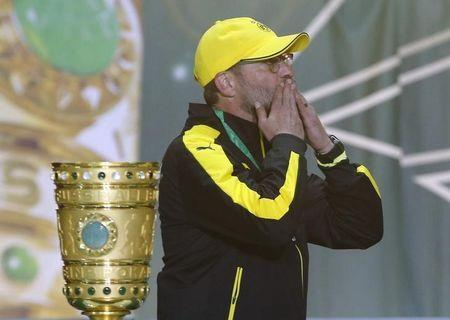 Borussia Dortmund coach Klopp acknowledges fans next to the trophy after German Cup final soccer match against VfL Wolfsburg in Berlin