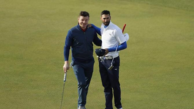 Spain's Alvaro Quiros and former Rugby Union player Brian O'Driscoll pose for a photo