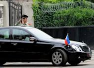File photo shows a Chinese paramilitary policeman saluting as the Philippines' ambassador's car leaves the embassy in Beijing on May 11. Philippine President Benigno Aquino has named a veteran diplomat, Sonia Brady, as the nation's new ambassador to China